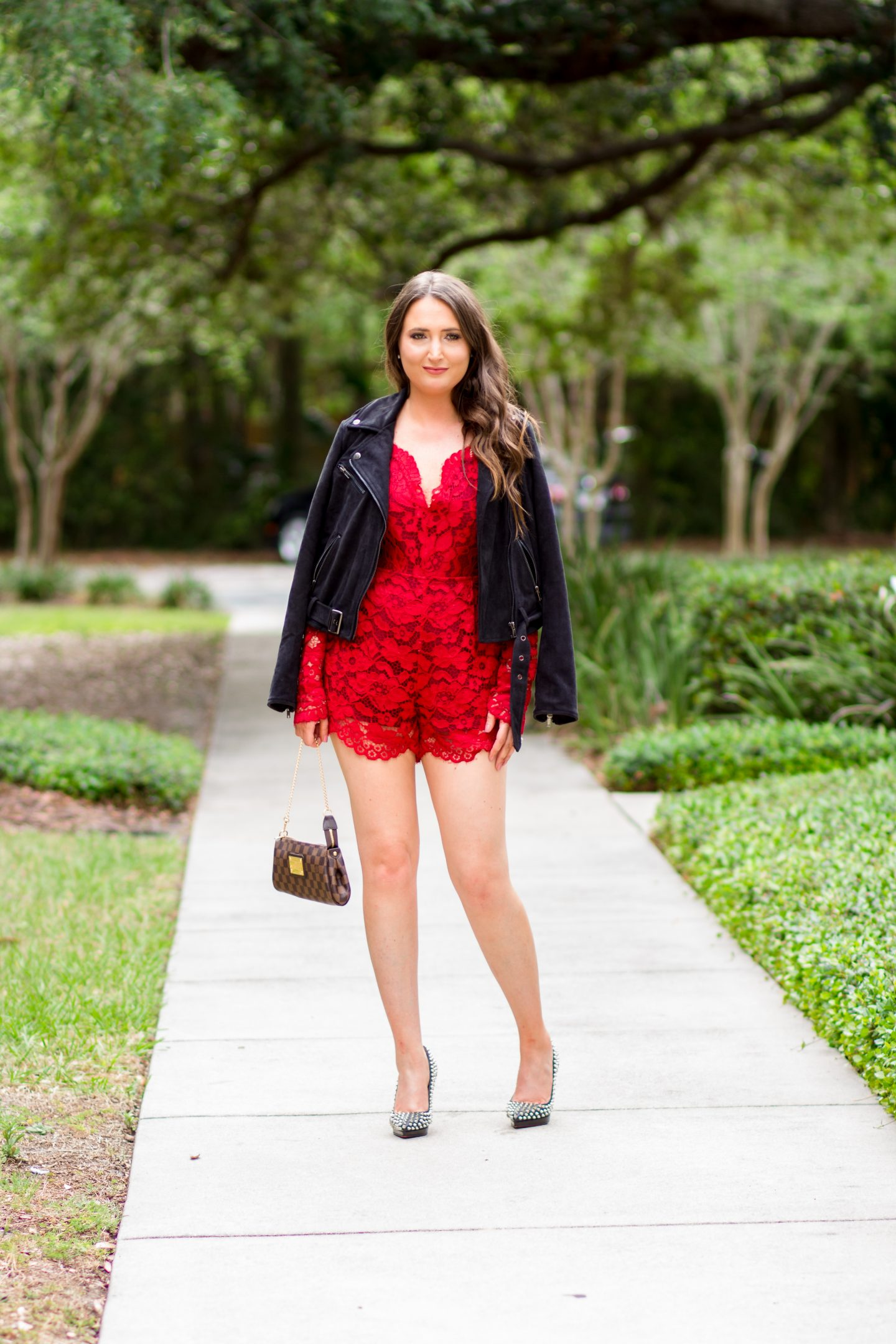 red lace romper, black suede jacket, louboutin spiked heels, louis vuitton eva clutch, lovers + friends, astr jacket