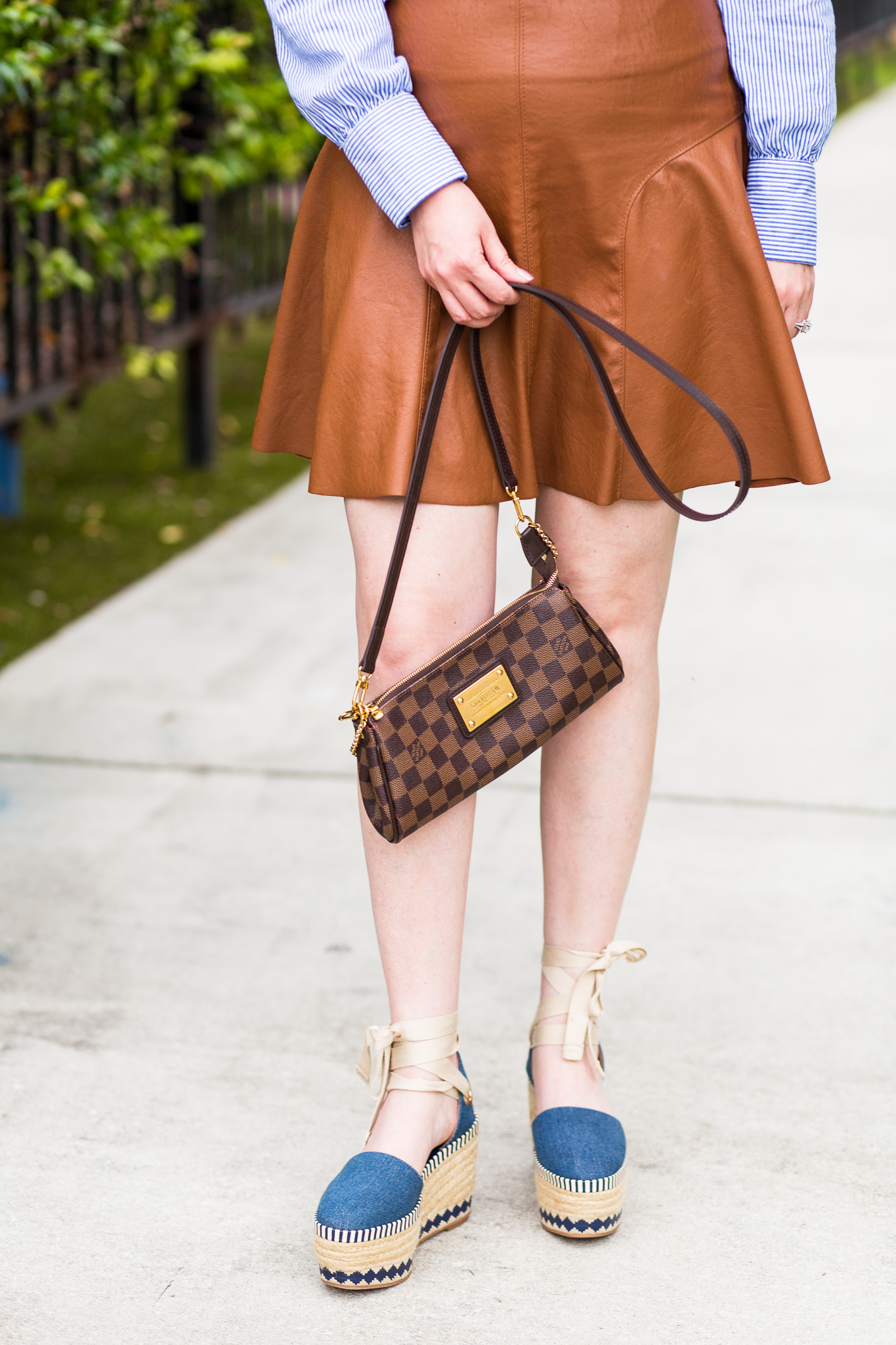 Summertime denim colors and espadrilles, summer fashion, striped top, cognac skirt, leather skirt, tory burch dandy espadrilles, louis vuitton eva clutch, mini skirt, summer outfit,