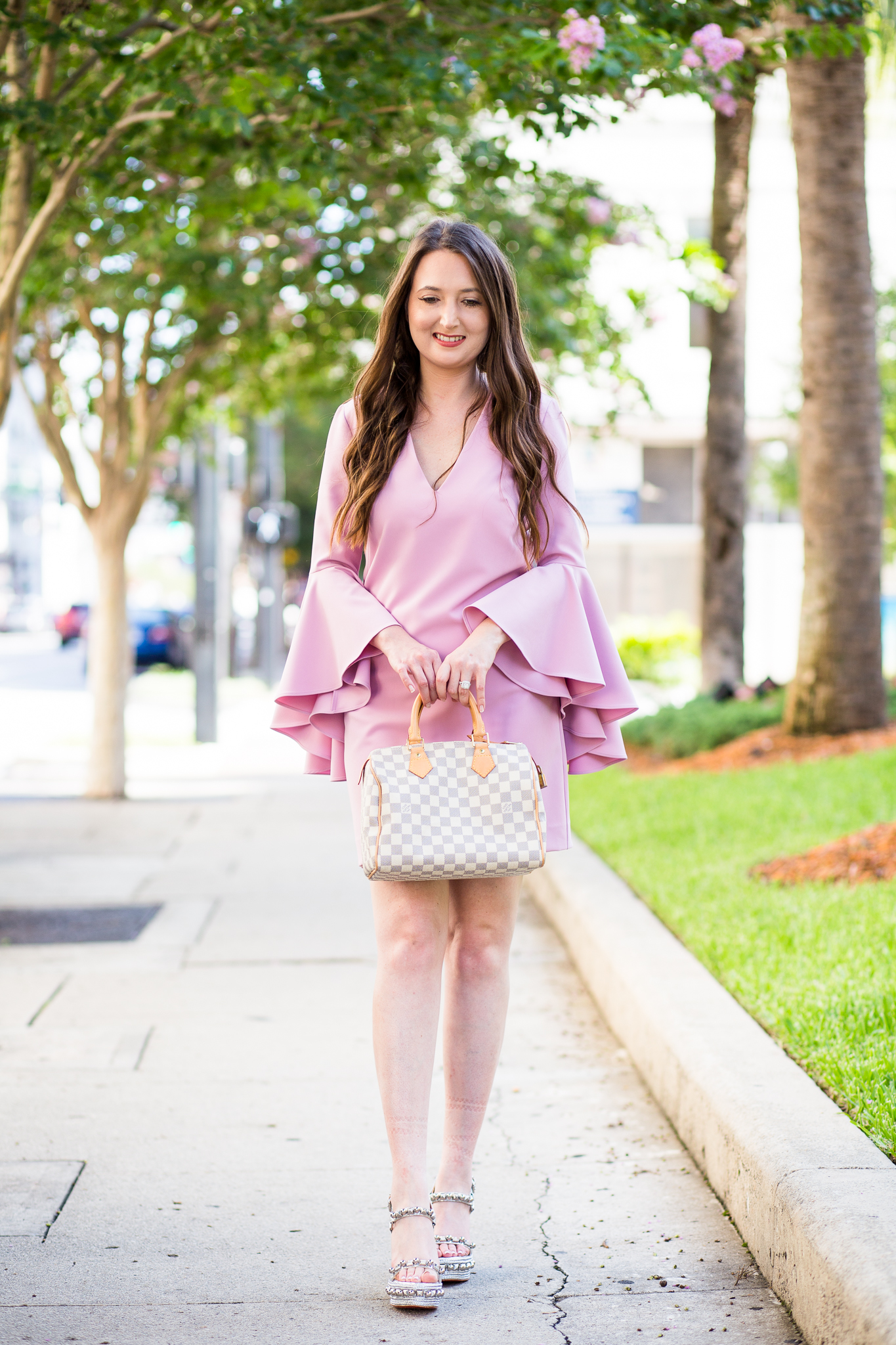 Ruffle me pink with bell-sleeves and studs