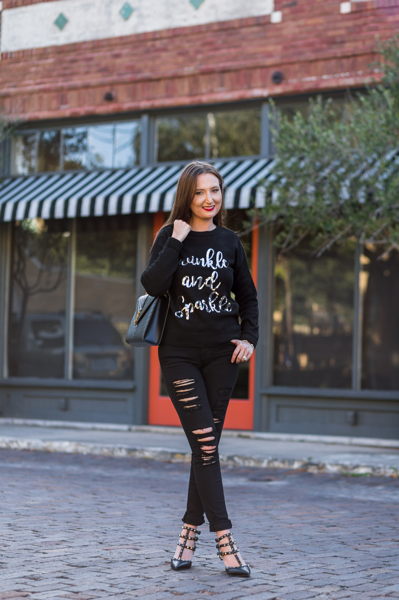 The best holiday sweater (for 32 dollars!)| holiday sweater, sequin sweater, asos sweater, frame denim, black distressed denim, black ripped jeans, saint Laurent shoulder bag, ysl bag, Valentino rockstud noir, fall fashion, fall fashion inspiration, frame le color rip skinny jeans, new look twinkle and sparkle sweater, fall fashion 2017
