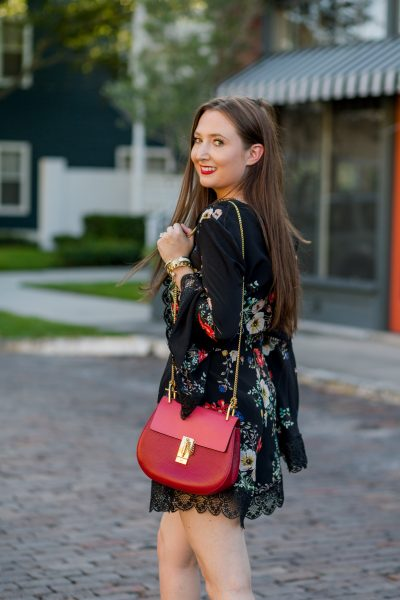 Holiday Festive Outfit Idea for the Southern Woman| Chloe drew red, holiday outfit, christian louboutin booties, fall fashion, romper, black floral romper, black suede booties, Why I sold my designer handbags, chloe drew