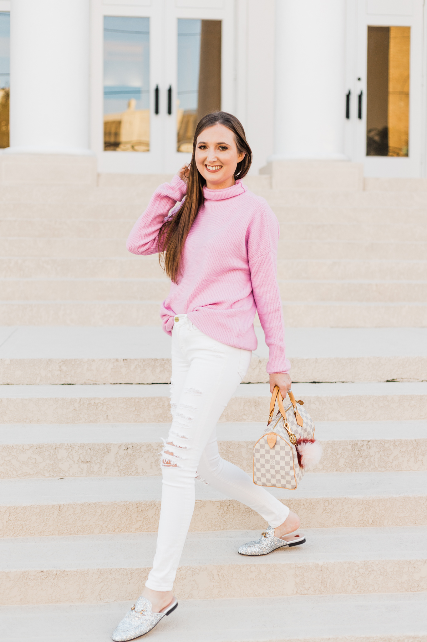 Pink oversized sweater, pink oversized sweater style inspiration, pink sweater, pink fluffy sweater, Gucci mules, Gucci glitter mules, white jeans, white ripped jeans, mules, pink and white outfit, Louis Vuitton speedy 25, pastel pink sweater