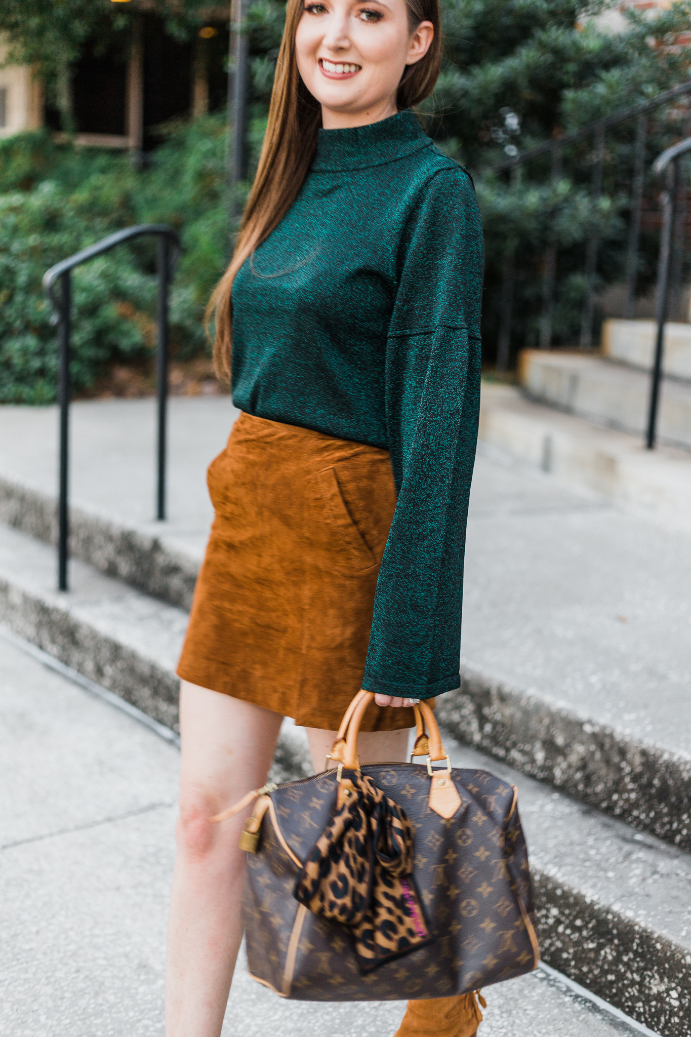 Sparkly green sweater and suede skirt