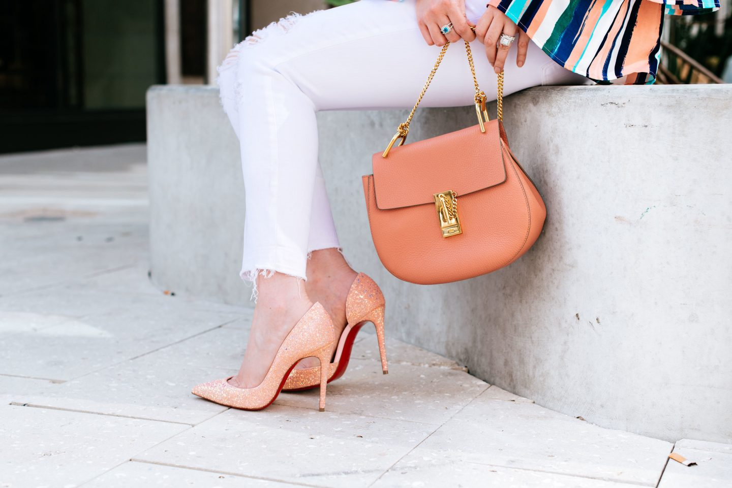 What To Buy in April: Designer Deals & Affordable Finds, white jeans, louboutin iriza, red bottoms, chloe drew small