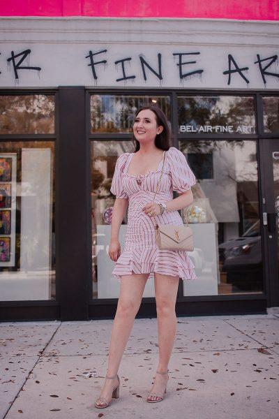 Jonathan Simkhai Striped Puff-Sleeve Ruffle Mini Dress | Saint Laurent wallet on chain | Stuart Weitzman nearly nude heels | David Yurman cable bracelet | Hermes clic h bracelet