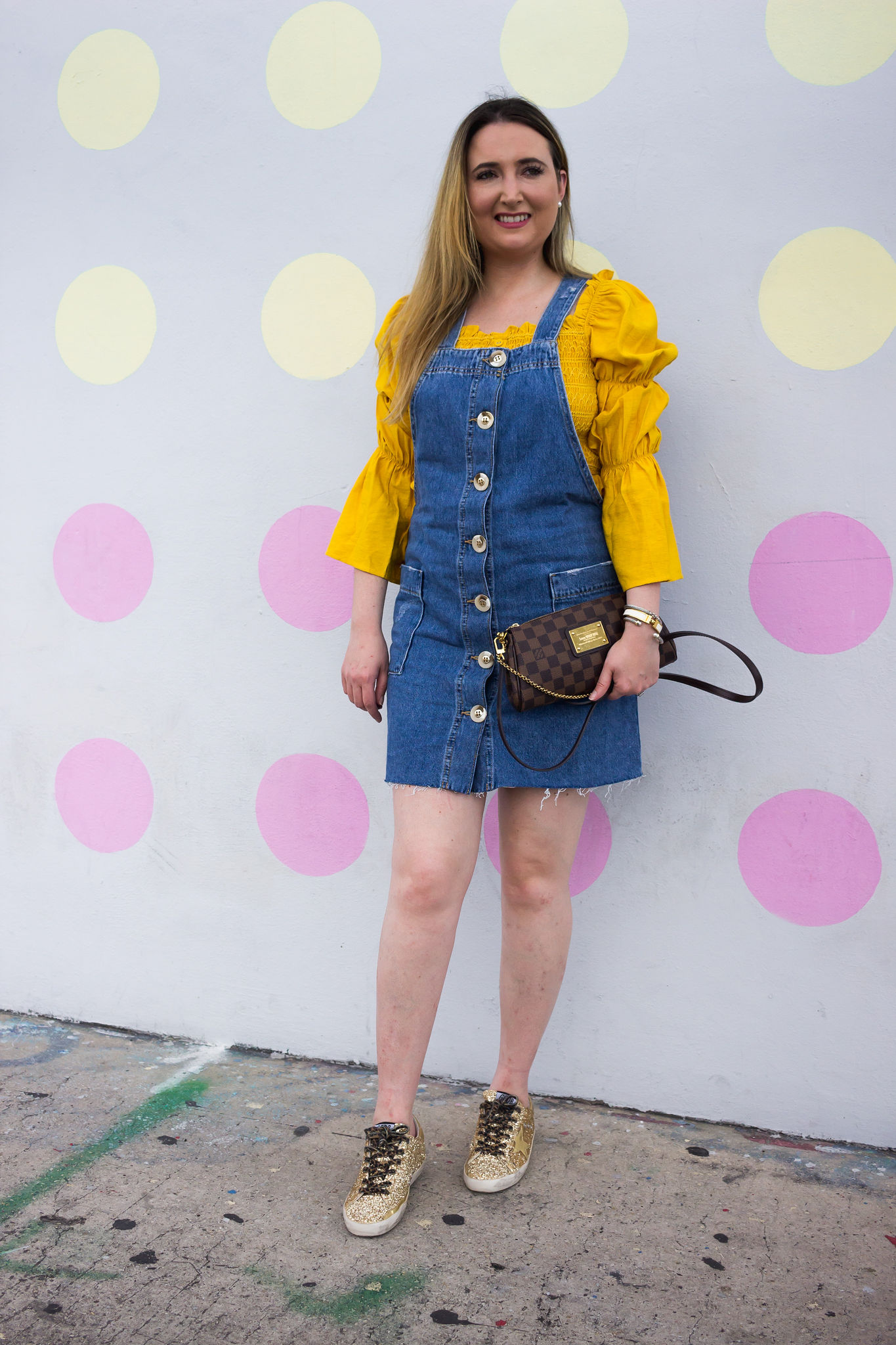 3 Summer Staples You Will Want To Wear On Repeat | Summer fashion staples | denim jumper dress | yellow statement top | yellow statement outfit | how to wear yellow | golden goose sneakers