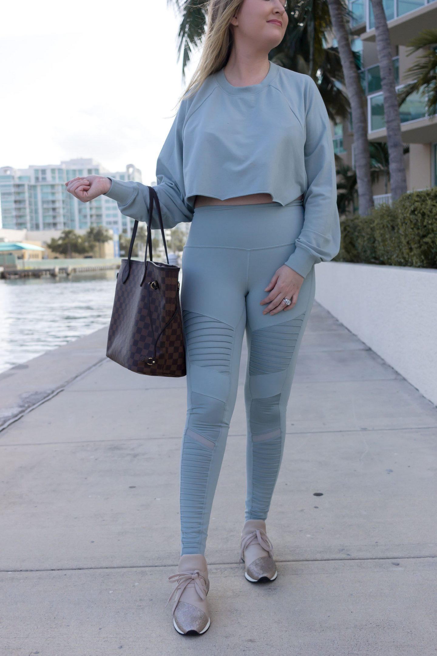 Athleisure Outfit That Will Motivate You To Hit The Gym, alo yoga, nordstrom anniversary sale athleisure, j slides zorro sneakers, louis vuitton neverfull mm damier ebene, alo yoga cropped sweater, alo yoga motto leggings, alo yoga matching outfit, matching athleisure, nsale