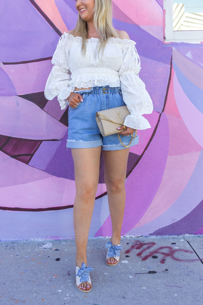 Comfortable Shorts Proven To Make You Look Skinnier, princess polly, princess polly boutique, paper bag denim shorts, ysl woc, ysl wallet on chain, white off the shoulder blouse, wynwood walls miami, miami wynwood, wynwood walls, dolce vita mules, dolce vita bow mules