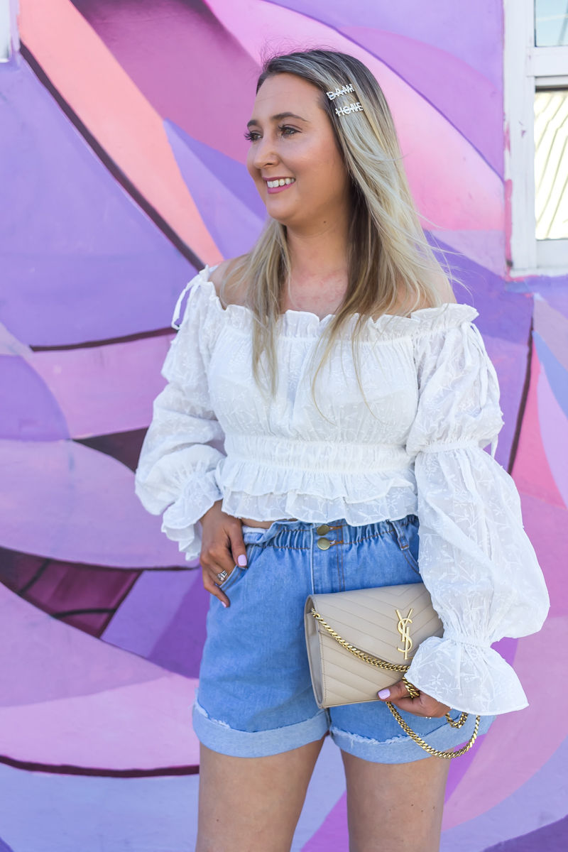 Comfortable Shorts Proven To Make You Look Skinnier, princess polly, princess polly boutique, paper bag denim shorts, ysl woc, ysl wallet on chain, white off the shoulder blouse, wynwood walls miami, miami wynwood, wynwood walls