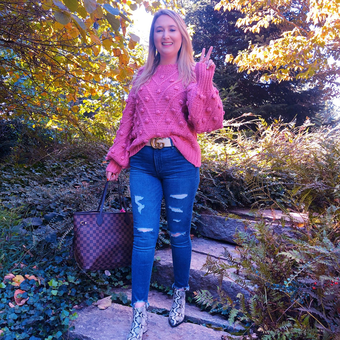 What To Wear In Asheville In Fall, pink pom pom sweater, asheville style, asheville fashion, gucci white belt, gucci marmont belt, seychelles snakeskin booties, snakeskin boots, louis vuitton damier ebene neverfull mm, abercrombie ripped jeans